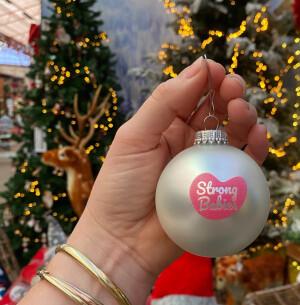 Logo Digitale kerstactie - koop een kerstbal en steun onderzoek